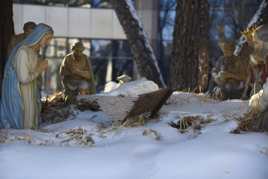 The nativity this year has a stand-in for the baby Jesus statue that went missing last December. On Dec. 9, 2019, the baby Jesus is played by a swaddled toy doll.
