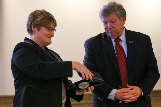 Dr. Lisa Dodson (left), dean of the Medical College of Wisconsin Central Wisconsin Campus, receives an endowment medal from Sentry chairman, president and CEO Peter McPartland on Monday, December 9, 2019, at SentryWorld in Stevens Point, Wis. Sentry has pledged $2 million to the MCW Central Wisconsin Campus to provide an endowment for the deanship and expanding training programs for local medical students. Tork Mason/USA TODAY NETWORK-Wisconsin