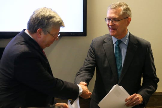 Dr. John Raymond (right), president and CEO of the Medical College of Wisconsin, shakes hands with Sentry chairman, president and CEO Peter McPartland on Monday, December 9, 2019, at SentryWorld in Stevens Point, Wis. Sentry has pledged $2 million to the MCW Central Campus to provide an endowment for the deanship and expanding training programs for local medical students. Tork Mason/USA TODAY NETWORK-Wisconsin