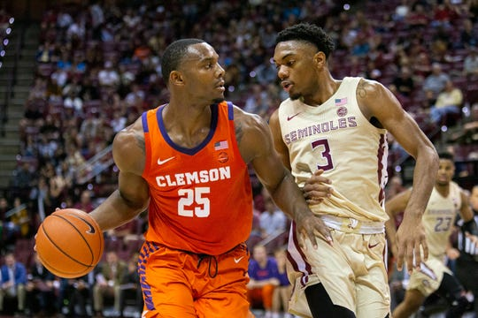 Clemson's Aamir Simms (25) brings the ball up the court against Florida State.