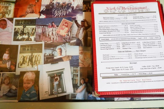 Photos line the front counter at Nick's Restaurant, which will be closing at the end of the year after being in business for three-generations on South Monroe Street.