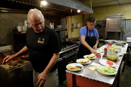 Jimmy Mitchell and his son, Nick Mitchell, work together in the kitchen of Nick's Restaurant, which has been in their family for three generations, Monday, Dec. 9, 2019. The South Monroe Street restaurant will close at the end of the year.