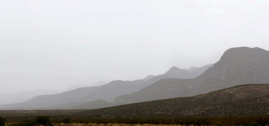 Low clouds give definition to the Franklin Mountains as a steady rain fall on El Paso Monday morning.