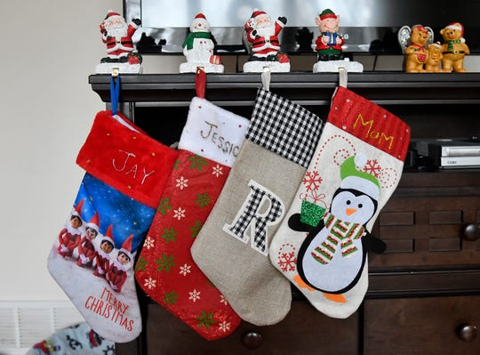 Christmas stockings hang inside Elizabeth Arce's temporary home. She is currently living in a leased house filled with rented furniture until plans to build a new home move forward.