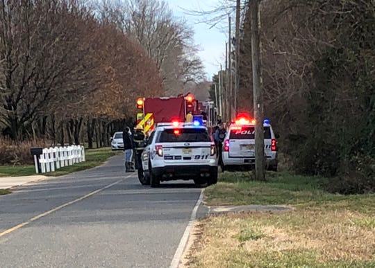 Vineland Police, assisted by Vineland firefighters, investigate a fatal single-vehicle crash along Piacenzia Avenue on Dec. 8, 2019.