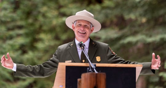 Woody Smeck, Superintendent for Sequoia and Kings Canyon National Parks, speaks to hundreds gathered Sunday, December 8, 2019 at the General Grant Tree in Kings Canyon National Park to observe the 93rd Annual Trek to the Nation's Christmas Tree Ceremony. Smeck later joined by two park rangers placed a memorial wreath placed at the base of the 267-foot tree.