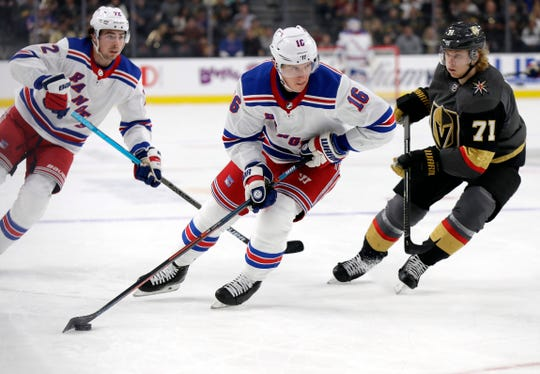New York Rangers forward Ryan Strome (16) skates down the ice as Vegas Golden Knights center William Karlsson (71) defends during the first period of an NHL hockey game Sunday, Dec. 8, 2019, in Las Vegas. (AP Photo/Isaac Brekken)