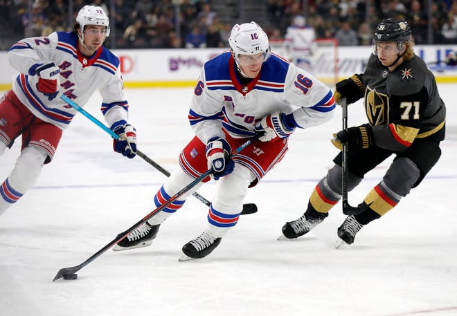 New York Rangers center Ryan Strome (16) skates down the ice as Vegas Golden Knights center William Karlsson (71) defends during the first period of an NHL hockey game Sunday, Dec. 8, 2019, in Las Vegas. (AP Photo/Isaac Brekken)