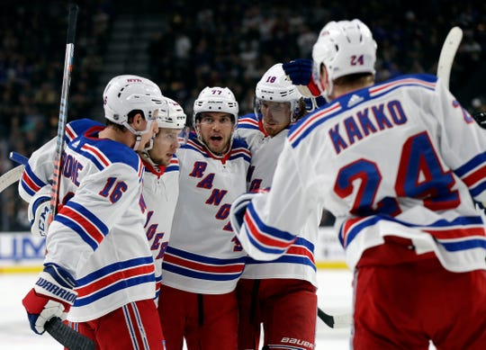The New York Rangers celebrate after a goal from left wing Artemi Panarin during the first period of an NHL hockey game against the Vegas Golden Knights Sunday, Dec. 8, 2019, in Las Vegas. (AP Photo/Isaac Brekken)