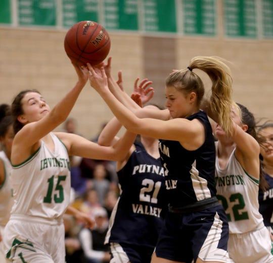 Katie Lebuhn of Irvington and Amanda Orlando of Putnam Valley battle for a rebound during a varsity girls basketball game at Irvington High School Dec. 9, 2019. Irvington defeated Putnam Valley 47-45.