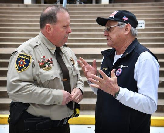 Wichita County Sheriff David Duke visits with Joel Jiminez after Duke announced he will run for re-election.