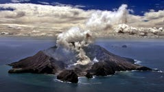 This file photo from Nov. 29, 1999, shows New Zealand's most active volcano on White Island in the Bay of Plenty giving off dense plumes of steam and gas.