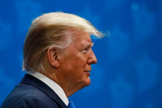 President Donald Trump listens as he is introduced at the Israeli American Council National Summit in Hollywood, Fla., Saturday, Dec. 7, 2019.