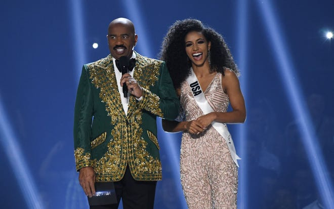 Steve Harvey and Miss USA Cheslie Kryst stand on stage during the 2019 Miss Universe pageant at the Tyler Perry Studios in Atlanta, Georgia on December 8, 2019.