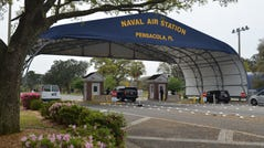 A handout file photo made available by the US Navy shows the main gate of the Naval Air Station (NAS) Pensacola in Pensacola, Florida.