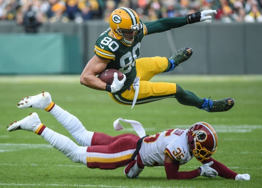 Washington safety Montae Nicholson tackles Green Bay tight end Jimmy Graham in the first quarter of a 20-15 Packers victory on Dec. 8, 2019, at Lambeau Field.