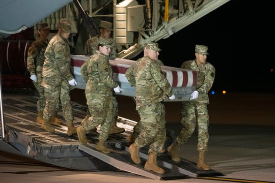 The remains of Ensign Joshua Kaleb Watson, fatally shot at the Naval Air Station Pensacola in Florida, are transferred at Dover Air Force Base in Delaware on Dec. 8, 2019.