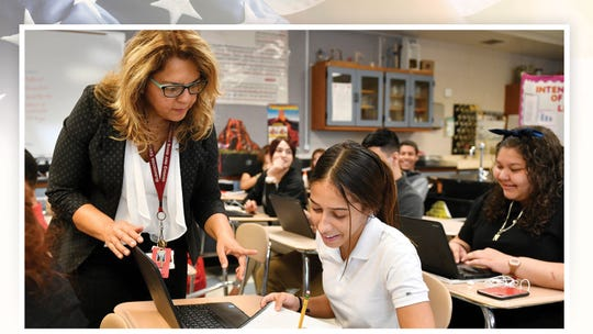 PLEASE TRANSLATE Luzmila Badillo-Gualdron works with Yarelis Ledesma, a bilingual student at Vineland High School on Sept. 30, 2019, in New Jersey.