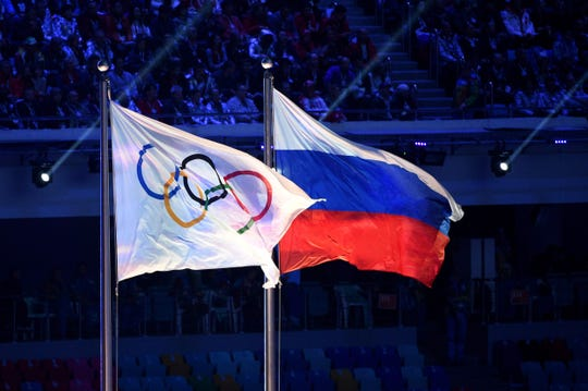 Olympic flag and Russian flag