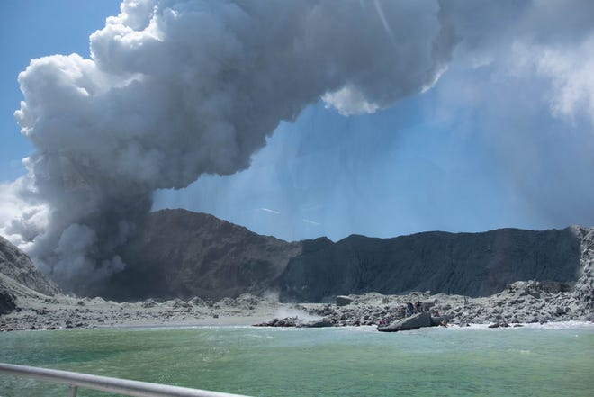 An image provided by visitor Michael Schade shows White Island (Whakaari) volcano, as it erupts, in the Bay of Plenty, New Zealand, Dec. 9, 2019.