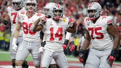 Ohio State wide receiver K.J. Hill (14) celebrates a touchdown during the second half of the Big Ten championship against Wisconsin.