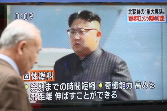A particular person walks past in entrance of TV screen showing North Korean leader Kim Jong Un in Tokyo, Monday, Dec. 9, 2019. North Korea acknowledged Sunday that it utilized a