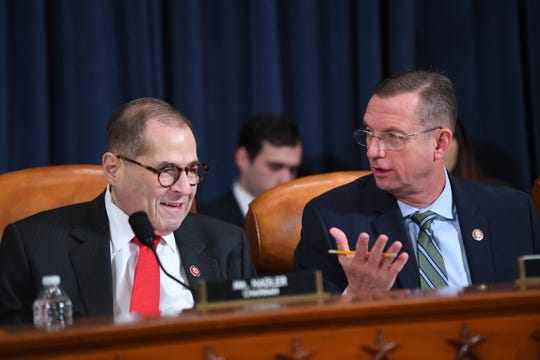 Rep. Jerry Nadler (D-NY), Chairman, Judiciary Committee, left, speaks with senior Republican on the Judiciary Committee, Doug Collins (R-GA) before the House Judiciary Committee receives counsel presentations of evidence as part of the impeachment inquiry into President Donald Trump on Dec. 9, 2019 in Washington.