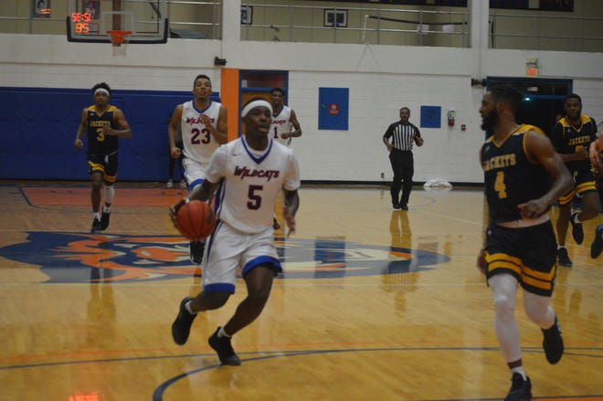 Louisiana College guard Kae'ron Baker (5) drives for two points against Howard Payne Monday.