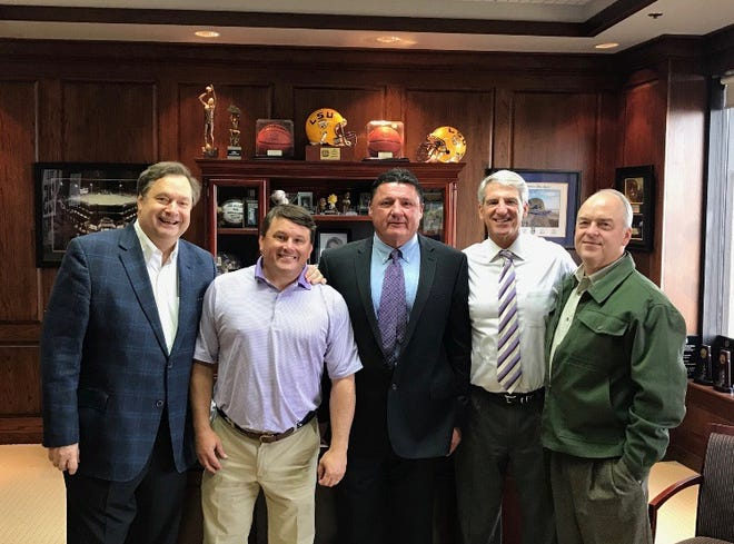 Ed Orgeron poses with four of the five members of the LSU search committee -- (from right) Alexandria's Blake Chatelain, former athletic director Joe Alleva, Scott Ballard and Stephen Perry -- after accepting the job as football coach in November 2016. Three years later, he has guided the Tigers to the SEC Championship, a 13-0 record and the top seed in the College Football Playoffs.