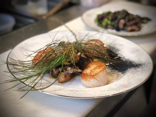 Seared scallops with roasted porcini, essence of white pine, and forest fire ash, from Park Place in Merchantville.