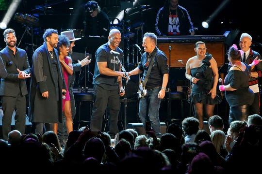 DMC and Bruce Springsteen perform onstage during the The Rainforest Fund 30th Anniversary Benefit Concert Presents 'We'll Be Together Again' at Beacon Theatre on December 09, 2019 in New York City.