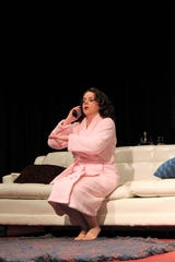 "Kate (Elise Pryor-Harden) is disturbed by the relationship between her husband their dog in his rehearsal scene from ""Sylvia,"" which concludes a two-weekend run at Abilene Community Theatre. Dec. 2 2019"