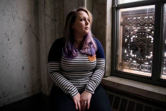 Cayley Winters poses for a portrait on Tuesday, Dec. 10, 2019 in Battle Creek, Mich. Winters worked as a certified nurse assistant at Bronson Hospital in Battle Creek for two years and endured assault from patients.