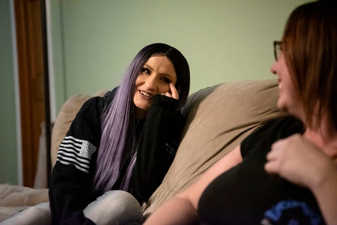 Dani Smith and Angela Pitcher share a laugh on Monday, Dec. 9, 2019 in Battle Creek, Mich. Angela's non-profit Home Pride Cleaning cleaned Dani's home for free while she recovered from chemotherapy.