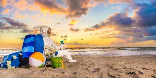 This image from the Space Coast Office of Tourism marketing campaign highlights two features of Brevard County, the beaches and the space program.