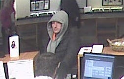 The suspect in a Tuesday morning robbery of People's United Bank in downtown Burlington, captured from a video.