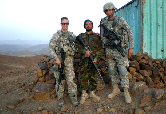 This undated photo shows then Col. William Roy of Jericho, left, posing with Lashkar, an Afghanistan army officer, and Vermont National Guard Sgt. Erik K. Morrill, right.