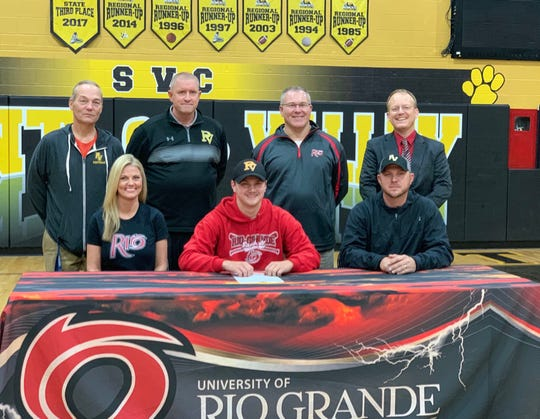 Lane Mettler signs to play college baseball at the University of Rio Grande on Monday, Dec. 9, 2019 at Paint Valley High School in Bainbridge, Ohio.  Front (L-R): Brianna Mettler, Lane Mettler, Jason Mettler; Back (L-R): Pete Hollon, Shayne Combs, Brad Warnimont, Lew Ewry