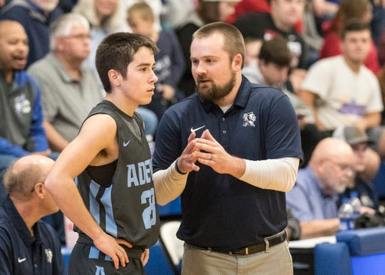 Adena head basketball coach Kyle Bradley talks to Brandon Smith during a game against Chillicothe High School on Monday, Dec. 9, 2019, in Chillicothe, Ohio.