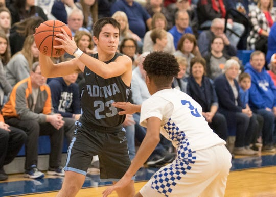Adena's Brandon Smith hangs on to the ball along the perimeter during a game against Chillicothe High School on Monday, Dec. 9, 2019, in Chillicothe, Ohio.