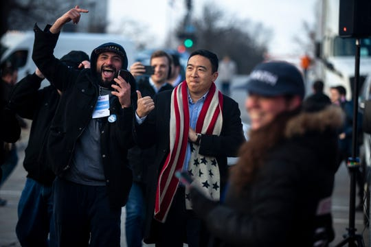 Andrew Yang, Democratic presidential candidate, walks up to his rally to kick-off his bus tour across the state on Tuesday, Dec. 10, 2019, on the steps of the Iowa State Capitol.
