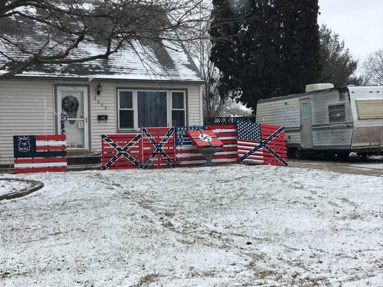The painted flag pallets in front of William Stark's home, which is right next to Morris Elementary School in Des Moines.