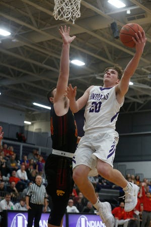 Indianola senior Blake Kennedy goes in for a layup. Indianola hosted Carlisle on Dec. 9, beating the Wildcats 71-55.