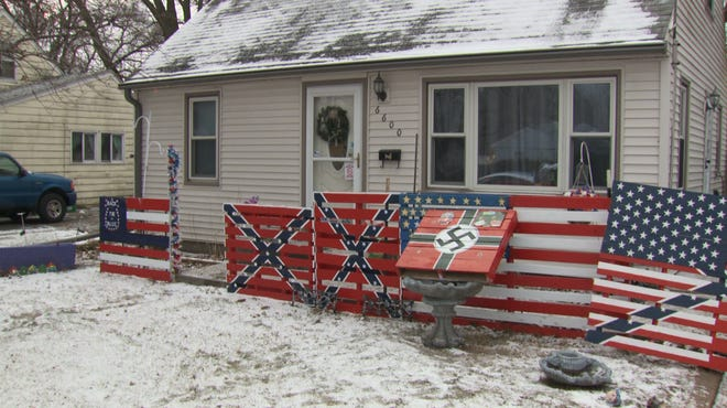 Iowa house diaplays swastika and confederate flag.