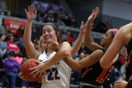 Indianola junior Kendall Clatt fights to hold on to a rebound. Indianola hosted Carlisle on Dec. 9, beating the Wildcats 69-47.