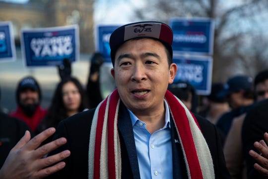 Andrew Yang, Democratic presidential candidate, talks with the press after kicking off his bus tour across the state on Tuesday, Dec. 10, 2019, on the steps of the Iowa State Capitol.