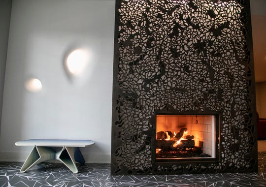 The fireplace in the walkout level of this home in Bloomfield Hills is wrapped with two layers of laser-cut steal and was created by sculptor Jodie Cooper. Photographed Tuesday Dec. 10, 2019.