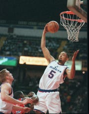 Bullets forward Juwan Howard comes down with the rebound the Detroit Pistons on Sunday, Oct. 29, 1995, at the Palacio de Deportes in Mexico City.