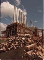 """This 1996 image shows  the Conners Creek power plant's """"Seven Sisters"""" and """"Two Brothers."""""""