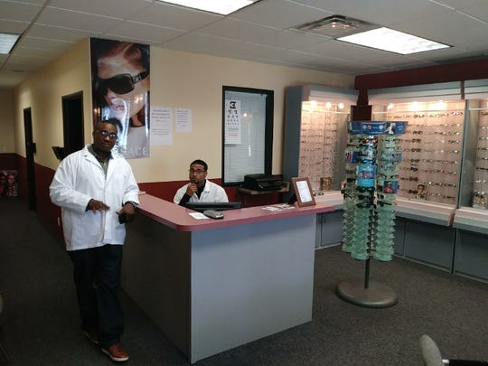 Roby Davis is pictured with his son Roby Davis at his eyewear business, Rosedale Vision, in Oak Park.